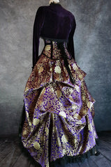purple and gold brocade bustle skirt and matching corset with purple velvet bolero shown on a mannequin from the back