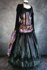 purple and gold brocade bustle skirt and matching corset with purple velvet bolero shown on a mannequin from the side front showing a black Alice Chemise worn under the corset
