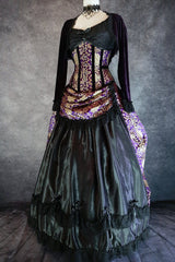 purple and gold brocade bustle skirt and matching corset with purple velvet bolero shown on a mannequin from the side front view showing purple velvet bolero shrug worn on top