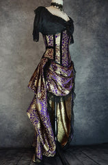 side front view of royal purple gold brocade victorian style bustle skirt with matching under bust corset trimmed in black velvet shown on a mannequin
