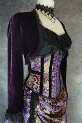 side front view of Royal Purple and gold velvet trimmed steel boned under bust victorian corset by gallery serpentine made in australia shown on a mannequin size 13