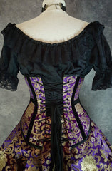 back view showing black corset lacing on the Royal Purple and gold velvet trimmed steel boned under bust victorian corset by gallery serpentine made in australia shown on a mannequin size 13