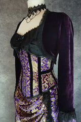side front view of the victorian style Royal Purple and gold velvet trimmed steel boned under bust victorian corset by gallery serpentine made in australia shown on a mannequin size 13