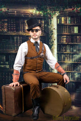 seated Wild West male model cosplaying Westworld character wearing flip top steampunk sunglasses