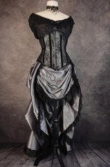 full length view from the front of the Australian made under bust tight lacing corset in a dark silver taffeta overlaid with delicate black lace and trimmed with black velvet ribbon down the corset bone channels