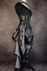 side view of the dark shot silver taffeta victorian style bustle skirt with matching black lace covered australian made steel boned corset shown on a mannequin