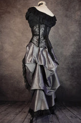 back view showing drape in the dark shot silver taffeta victorian style bustle skirt with matching black lace covered australian made steel boned corset shown on a mannequin