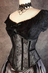 Australian made under bust tight lacing corset in a dark silver taffeta overlaid with delicate black lace and trimmed with black velvet ribbon down the corset bone channels