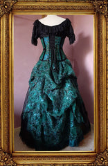 back view of the peacock brocade corset and green lace ball gown set