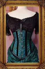 front view of the peacock brocade under bust victorian corset trimmed with black velvet