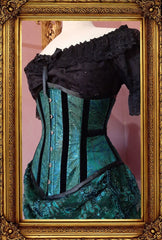 side front view of the awesome peacock brocade under bust corset, trimmed with black velvet