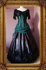 front view of the peacock brocade and green lace bustle skirt ball gown