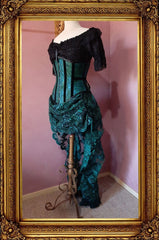 side front view of the peacock brocade corset worn with the matching green lace victorian bustle skirt