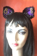 worn on a head are the purple miaow amethyst satin, faux black fur, steampunk cogs, handcrafted bespoke steampunk kitty ears made in Western Australia, exclusive stockist is Gallery Serpentine