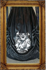 unique crest screen print close up on black satin version of the Victorian Ravenclaw inspired satin skirt and hoop skirt made in Australia for Gallery Serpentine
