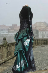 side back view showing the serpent and scroll print on the bolero sleeve as part of the Potion Mistress Corset Gown made in Australia for Slytherin fandom in a baroque style