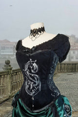 front view of the Mistress Potion corset showing the ornate baroque detailing and the cinched in waist curve