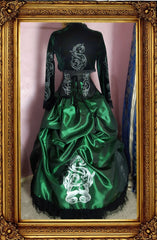 showing the back of the emerald screen printed skirt as part of the Slytherin inspired fandom cosplay costume made by Gallery Serpentine