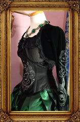 side view of the dark emerald green stretch velvet shrug and screen printed corset as part of the Slytherin fandom inspired victorian corset gown