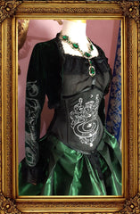 side front view of the dark emerald green stretch velvet shrug and screen printed corset as part of the Slytherin fandom inspired victorian corset gown