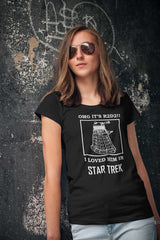 Karyn leaning against a wall because she's very cool in her OMG It's R2D2 Dalek tshirt