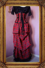 red stewart tartan victorian bustle skirt with matching corset and black bolero shown from the back view with an under corset top in black broderie anglaise included