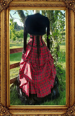 back view of the victorian punk corset ball gown in red stewart tartan fabric in an outdoor setting