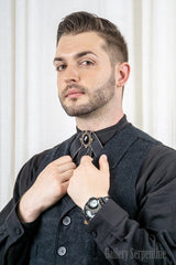 male model showing the black version of the An old wild west frontier style tie with a modern gothic and steampunk twist