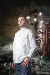 steampunk model in steampunk setting with copper still wearing the timeless victorian era men's shirt in 100% white cotton true to the design and pattern of the old west era late 1800s