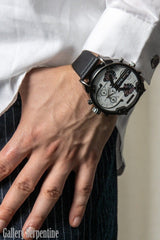 worn with a white shirt is the 'My Watch is Bigger than your watch' oversized white faced multi time zone pilot retro steampunk style watch