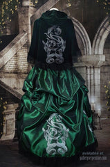 full length showing the deluxe Slythering Cape for Harry Potter Slytherin House cosplay costume made of dark green velvet, 62cm long, hand screen printed with double silver snakes and baroque letter S worn over a matching green gown