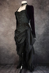 side view of the Venus over bust steel boned corset made in Australia worn with a dark purple velvet Bolero and draping victorian style bustle skirt