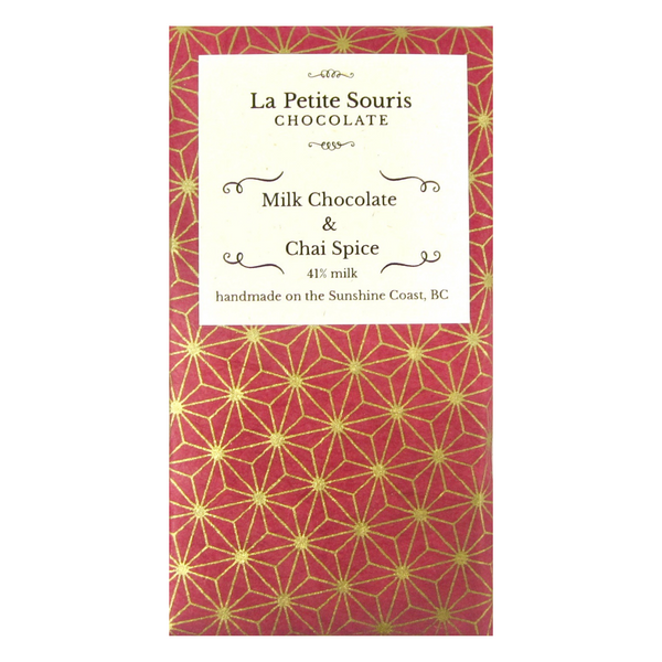 Our milk chocolate bar with chai spices.  Wrapper is burgundy with a geometric gold pattern.