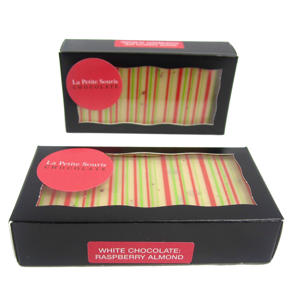 White chocolate in a black window box, with cocoa butter motif in red and green stripes.  Sticker says: white chocolate, raspberry almond.