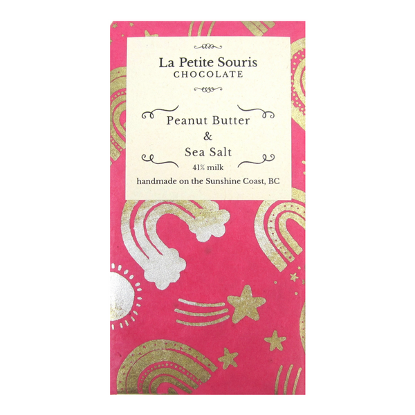 Peanut butter and sea salt bar wrapped in natural colour, handmade paper with rainbow motif in metallic gold on pink paper.
