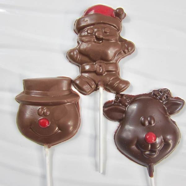 three chocolate lollipops, santa with a red hat in milk chocolate, snowman with a red nose in milk chocolate and a reindeer with a red nose in dark chocolate