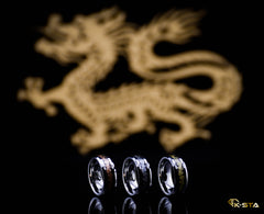 Three mens wedding bands with dragon background