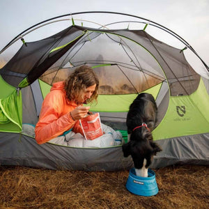 Ruffwear Bivy Travel Dog Bowl dog in tent eating out of it