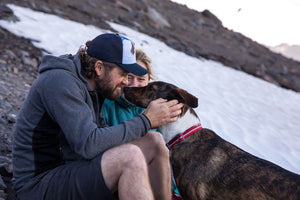 Ruffwear Red Crag Collar lifestyle shot with happy dog and man