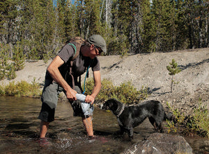 Soaking the Ruffwear Swamp Cooler in a stream