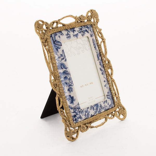 KITI gilt bronze photo frames with porcelain