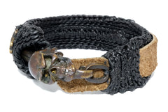 leather bracelet with a skull lock center