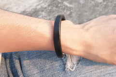 Silver bangle with leather top