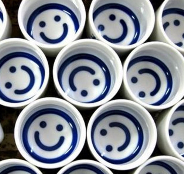 Smiley face sake cup