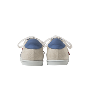 Women sneakers in raw linen with handmade embroidered blue and white beads with a zigzag pattern, leather lining, blue leather outline, blue leather back, white natural gum sole and blue satin laces - back view