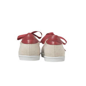 Women sneakers in raw linen with handmade embroidered red and white beads with a zigzag pattern, leather lining, red leather outline, red leather back, white natural gum sole and red satin laces - back view