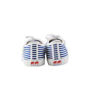 White and blue striped canvas sneakers, white vulcanized natural gum sole and white cotton laces. Twins for Peace logo on the sole back - back view