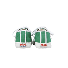 Load image into Gallery viewer, Green canvas sneakers with white outlines, white vulcanized natural gum sole and white cotton laces. Twins for Peace logo on the back of the sole - back view