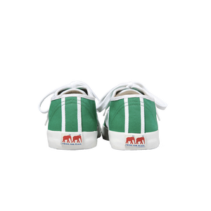Green canvas sneakers with white outlines, white vulcanized natural gum sole and white cotton laces. Twins for Peace logo on the back of the sole - back view