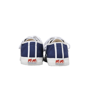 Blue canvas sneakers with white outlines, white vulcanized natural gum sole and white cotton laces. Twins for Peace logo on the back of the sole - back view